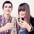 Young, attractive, happy, smiling couple celebrating with champa — Foto de Stock