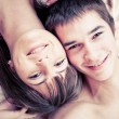 Young happy couple in bed — Stockfoto