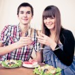 Young, attractive, happy, smiling couple celebrating with champa — Stock Photo