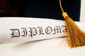 Graduation hat and Diploma — Stock Photo