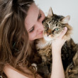Beautiful smiling brunette girl and her  cat over — Stock Photo