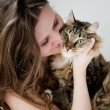 Beautiful smiling brunette girl and her cat over — Stock Photo #24594313