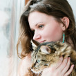Beautiful smiling brunette girl and her  cat over — Stok fotoğraf