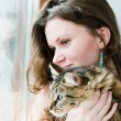 Photo: Beautiful smiling brunette girl and her cat over