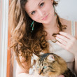 Beautiful smiling brunette girl and her cat over — Stock Photo #24594719