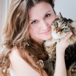 Beautiful smiling brunette girl and her cat over — Stock Photo #24594861