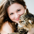 Beautiful smiling brunette girl and her cat over — Stock Photo #24594961