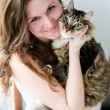 Beautiful smiling brunette girl and her cat over — Stock Photo #24595045