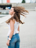 Beautiful european woman with hair flying — Stock Photo