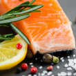 Fresh salmon with spices — Stock Photo
