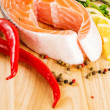 Salmon with lemon and pepper — Stock Photo #26875597