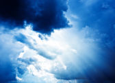 Bright sun in blue sky with clouds — Stock Photo