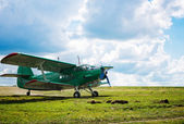Old airplane on green grass — Stock Photo