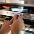 Hand moving the timer knob on the  oven — Stock Photo