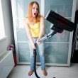 Woman cleaning the house with the Vacuum Cleaner — Foto Stock