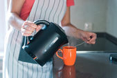 Pouring hot drink to the mug — Stock Photo