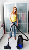 Woman cleaning the house with the Vacuum Cleaner — Stock Photo