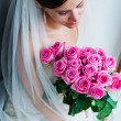 Fascinating bride with roses — Stock Photo
