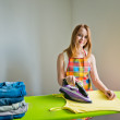Young beautiful woman ironing clothes in room — Photo