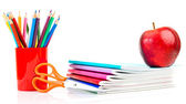 Notebooks, pencils and apple. — Stock Photo