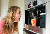 Shock woman making coffee cup machine kitchen interior — Stock Photo