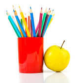 Pencils and apple. — Stock Photo