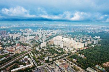 Skyline with dark grey autumn clouds under big city, Moscow