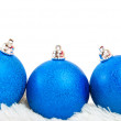 Three blue Christmas ball on white fur — Stock Photo