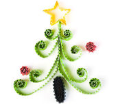 Christmas tree made of paper on white background — Stock Photo
