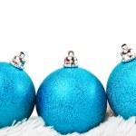 Three blue Christmas ball on white fur — Stock Photo #37047101