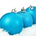 Three blue Christmas ball on white fur — Stock Photo #37047231
