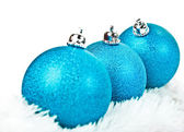 Three blue Christmas ball on white fur — Stock fotografie
