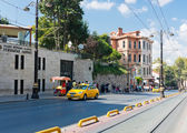 Yellow taxi driving in downtown of Istanbul — Стоковое фото