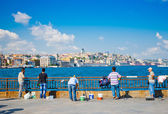 People fish near the Galata bridge Istanbul — Stok fotoğraf