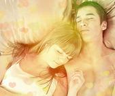 Dormindo em uma cama de casal — Fotografia Stock