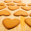 Heart shaped cookies on wooden table background — Stock Photo