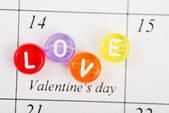 Calendar page with LOVE on February 14 of Saint Valentines day. — Stock Photo