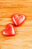 Hearts on wooden background — Stockfoto