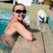 Woman smiling in a swimming pool — Stock Photo