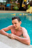 Man  in the swimming pool — Stock Photo