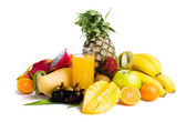 Juice in glass and tropical fruit — Stock Photo