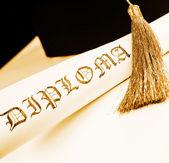 Graduation hat and Diploma — Stock Photo