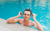 Man posing in the swimming pool — Stock Photo