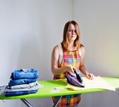 Sad woman of doing the ironing. — Stock Photo