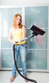 Woman cleaning the house — Stock Photo