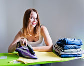 Woman ironing clothes. — Stock Photo