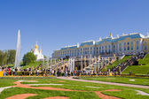 Tourists visit the sights of the lower park of Peterhof  — Stock Photo