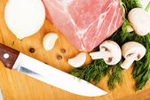 Raw fresh meat on board — Stock Photo