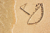 Drawing of sailboat on sand  — Stock Photo