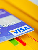 Visa Debit Card  in wallet and other cards. — Stock Photo